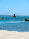 Sailing boat on the adriatic sea rocks beach and Royalty Free Stock Images