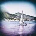Sailing boat on Aegean sea near Nisyros Island Royalty Free Stock Photo
