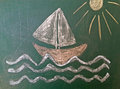 Sailing boat drawn on green chalk board