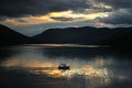 Sailing boat on loch earn in scottish highlands view the during colored sunset Royalty Free Stock Photo