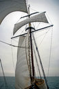 Sailing boat on Northern Sea sails wind water storm Royalty Free Stock Photo
