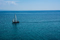 Sailing boat at an open sea Royalty Free Stock Photo