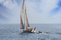 Sailing boat in open waters Stock Image