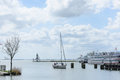 Sailing boat is sailing into the historic maritime harbor town o Royalty Free Stock Photo