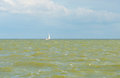 Sailing boat sailing over a stormy lake in summer Royalty Free Stock Photo