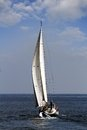 Sailing boat sloop in open waters Stock Image