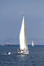 Sailing boat sloop in open waters Stock Images