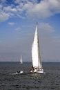 Sailing boat sloop in open waters Royalty Free Stock Images
