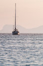 Sailing boat at sunrise sailboat in the sea Royalty Free Stock Image