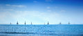 Sailing boat yacht regatta race on sea or ocean water sailboat group panoramic view Stock Photo