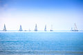 Sailing boat yacht regatta race on sea or ocean water sailboat group panoramic view Royalty Free Stock Images