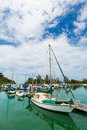 Sailing boats docked at the shore Stock Images