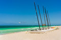 Sailing boats and pedalos on a beach in cuba seaside marina the famous of varadero Royalty Free Stock Images