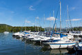Sailing boats and yachts with masts in a row on a lake with beautiful blue sky Royalty Free Stock Photo