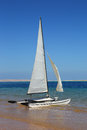 Sailing catamaran on beach sea Royalty Free Stock Photo