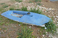 A sailing dinghy destroyed topper washed up onto the shore after storm Royalty Free Stock Image