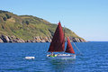 Sailing dinghy off dartmouth devon Stock Photo