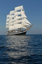 Sailing frigate under full sail in the ocean Stock Photos
