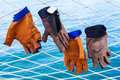 Sailing gloves hanging on the nets  of yacht  with blue ocean ba Royalty Free Stock Photo