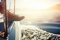 Sailing lifestyle feet on boat at sunrise Stock Photos