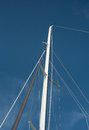 Sailing mast white against blue sky Stock Photography