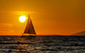 Sailing-orange sunset Royalty Free Stock Photo