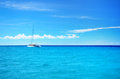 Sailing party catamaran in the blue carribean sea and cloudscape Royalty Free Stock Photo