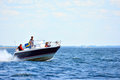 Sailing and power boat on the open sea Royalty Free Stock Images