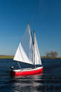 Sailing in a red small boat Royalty Free Stock Photography