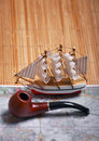 Sailing ship, map and pipe Stock Photo