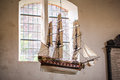 Sailing ship model of a hanging in a church Royalty Free Stock Photos