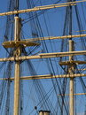 Sailing ship tackle two tall masts of a classic with booms platforms and wires Royalty Free Stock Images