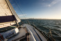 Sailing on a sunny day to san francisco racing sailboat heeled over as it picks up wind in bay Stock Photos