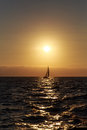 Sailing and sunset sailboat against a beautiful Stock Photography