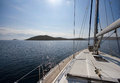 Sailing towards the island Stock Photography
