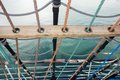 Sailing vessel marine rope ladder at pirate ship sea hemp ropes on the old nautical ladder upstairs on the mast Royalty Free Stock Images