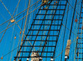 Sailing vessel rope ladder to the main mast of the ship rigging marine ropes and pulleys on the old ship ancient marine background Stock Images