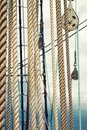 Sailing vessel sea hemp ropes and pulleys on the old nautical Stock Photos