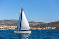 Sailing in the wind through the waves at Aegean Sea in Greece. Royalty Free Stock Photo