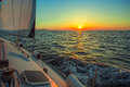 Sailing in the wind through the waves during sunset at the Aegean Sea in Greece. Royalty Free Stock Photo