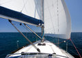 Sailing yacht on back wind on blue sea and blue sky Royalty Free Stock Photo