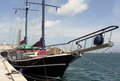 Sailing yacht berthed in port a traditional a mediterranean harbour harbor photographed on a sunny day showing harbour harbor wall Royalty Free Stock Images