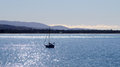 Sailing yacht in bright sunny blue ocean in Tasmania bay Royalty Free Stock Photo
