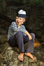 Sailor boy sitting on a stone Royalty Free Stock Photo
