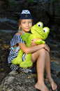 Sailor girl with a toy frog Royalty Free Stock Photo