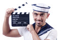 Sailor with movie clapper on white Royalty Free Stock Images