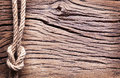 Sailor's knot over old wood. Royalty Free Stock Photos