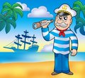 Sailor with spyglass on beach Royalty Free Stock Photography