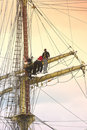 Sailors on sailboat rigging Royalty Free Stock Photo