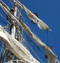 Sailors unfolding the sails Royalty Free Stock Photo